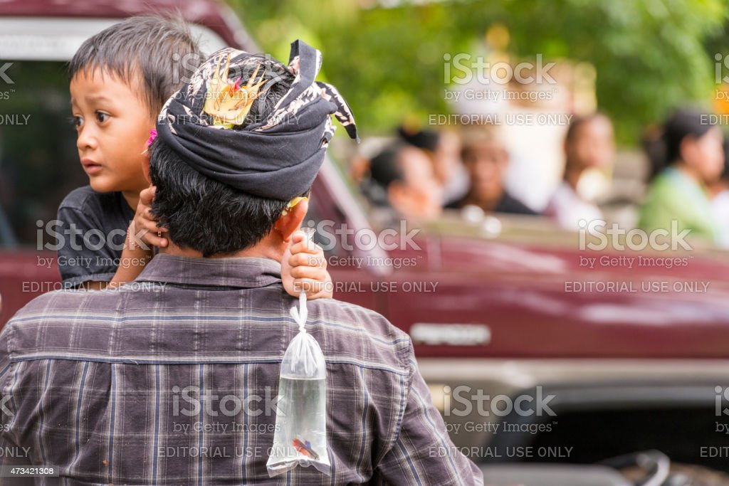 Balinese Father and Son at Traditional Hindu Ceremony Indonesia stock photo
