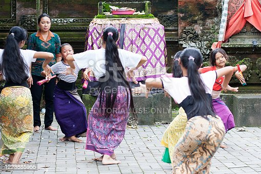 Bali, Indonesia - February 14, 2017: Colour photograph of Balinese all female street dance troop practising traditional dance moves in Ubud region.