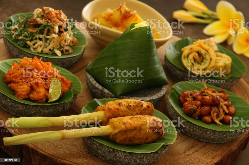 Balinese Food Sampler on Wooden Board stock photo