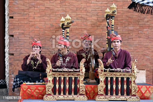 Bali, Indonesia - may 24, 2017: Balinese Gamelan orchestra perform playing traditional ritual music at Art and Culture Festival in Bali, Indonesia