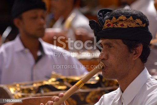 Bali, Indonesia - July 28 2019:Balinese gamelan orchestra playing traditional music. Gamelan is the traditional ensemble music of Java and Bali in Indonesia, made up predominantly of percussive instruments.