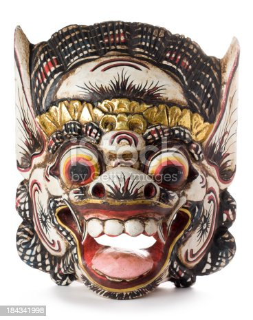 A Balinese Barong mask isolated on a white background.