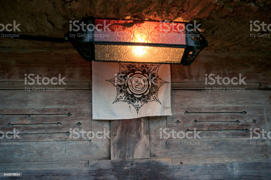 Balinese lantern decorated with symbol of Om stock photo
