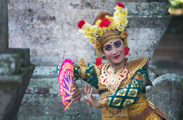 balinese legong dancer in traditional outfit stock photo