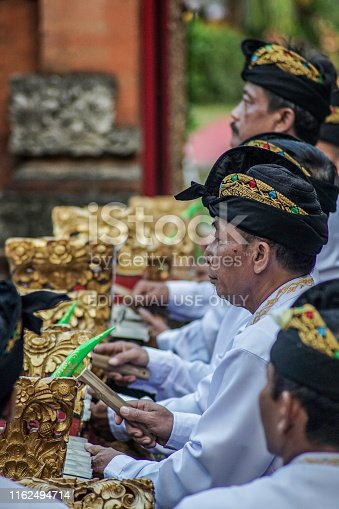 Jakarta, July 2019 - Balinese Man Playing Traditional Music in Odalan Traditional Ceremony in Jakarta