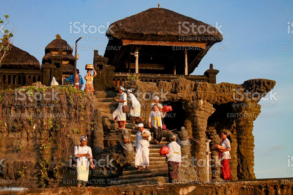 Balinese People In Traditional Clothes Going To Temple At