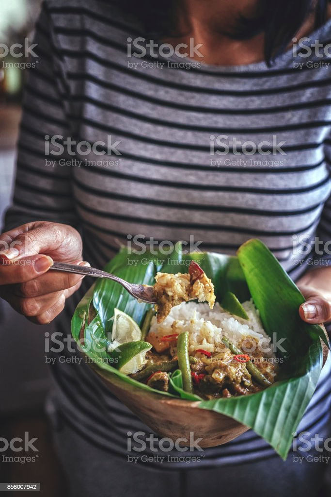 Balinese Pork Curry Dish with Jasmine Rice Served on Banana Leave stock photo