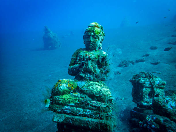 Balinese statues creating an artificial coral reef stock photo