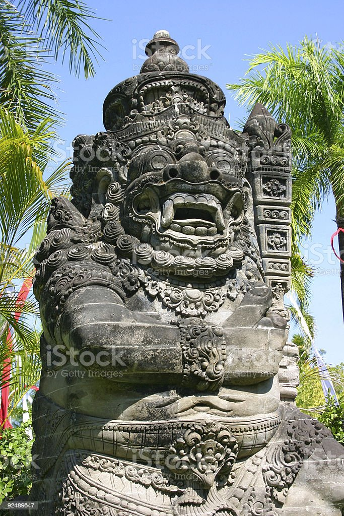 Balinese stone sculpture in Indonesia royalty-free stock photo