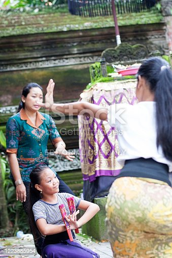 Bali, Indonesia - February 14, 2017: Colour photograph of Balinese Street dance troops practising traditional dance moves in Ubud region.