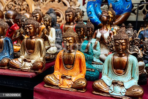 Balinese traditional souvenirs - metal statues of Buddha in different poses.