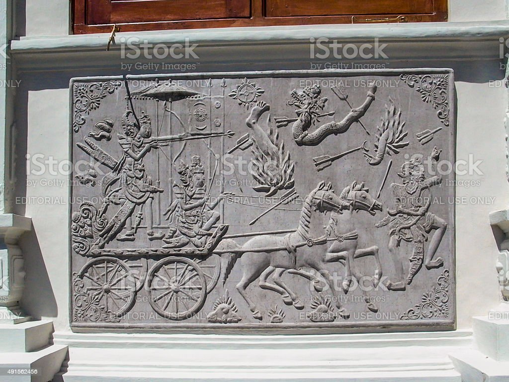 balinese warriors with horses at a plate at temple Ujung stock photo