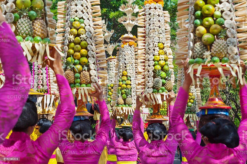 Balinese women in traditional costumes with offerings for ceremony stock photo