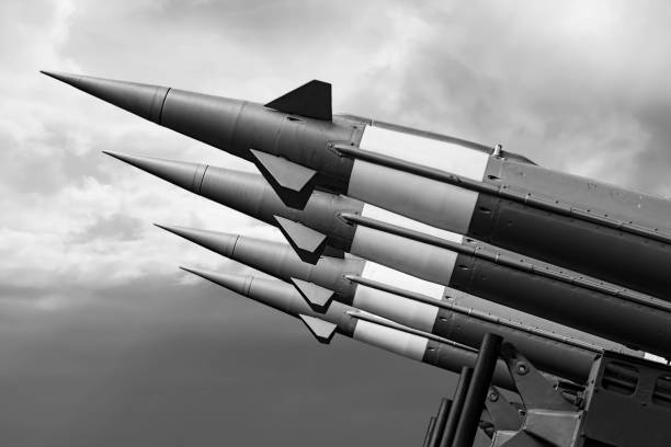 Balistic Rockets War Background. Nuclear Missiles With Warhead Aimed at Gloomy Sky. Balistic Rockets War Background. Nuclear Missiles With Warhead Aimed at Gloomy Sky. antiaircraft stock pictures, royalty-free photos & images