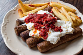 Balkan Cevapcici Kofta / Kofte Kebab with Yogurt, Tomato Sauce and Potatoes