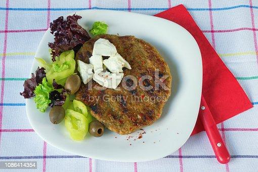 istock Balkan cuisine. Pljeskavica - a grilled dish of minced meat 1086414354
