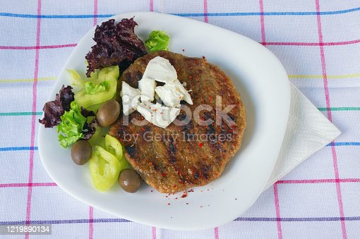 istock Balkan cuisine. Pljeskavica - grilled dish of minced meat 1219890134