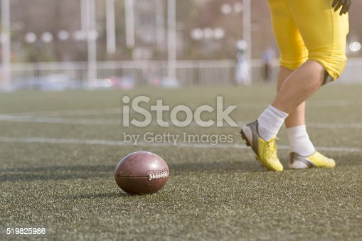 1176737230istockphoto Ball and American football player on the field 519825986