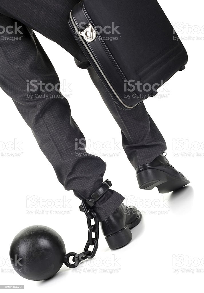 Ball and chain on businessman stock photo