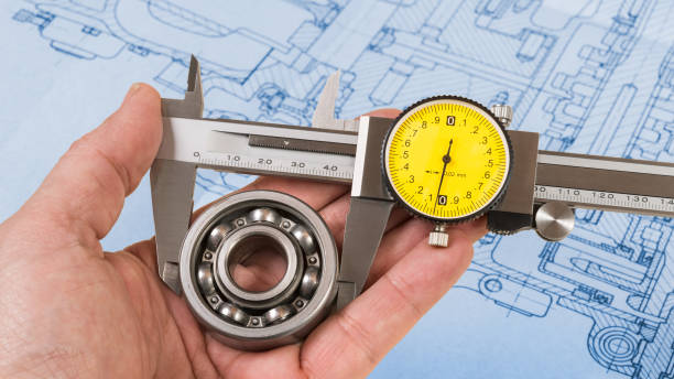 ball bearing diameter measurement. vernier caliper in technician hand. technical drawing - diameter stock pictures, royalty-free photos & images