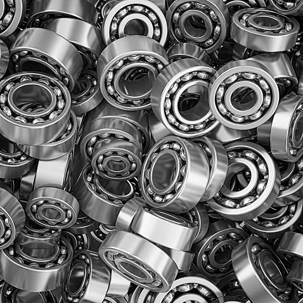 ball bearings metal ball bearings heap directly above view. ball bearing stock pictures, royalty-free photos & images