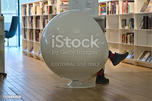 Helsinki, Finland – February 6, 2020: The ball chair provides a peaceful resting place. Oodi Libray is a popular meeting place in middle of city and has voted for world's best new library in 2019.