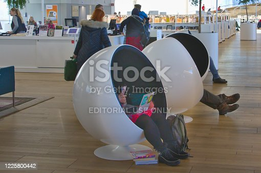 Helsinki, Finland – February 6, 2020: A ball chairs provide a peaceful places to rest Oodi Libray is a popular meeting place in middle of city and has voted for world's best new library in 2019.