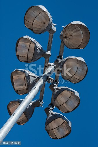 508552962 istock photo Ball Field Lights Against a Blue Sky 1041951498