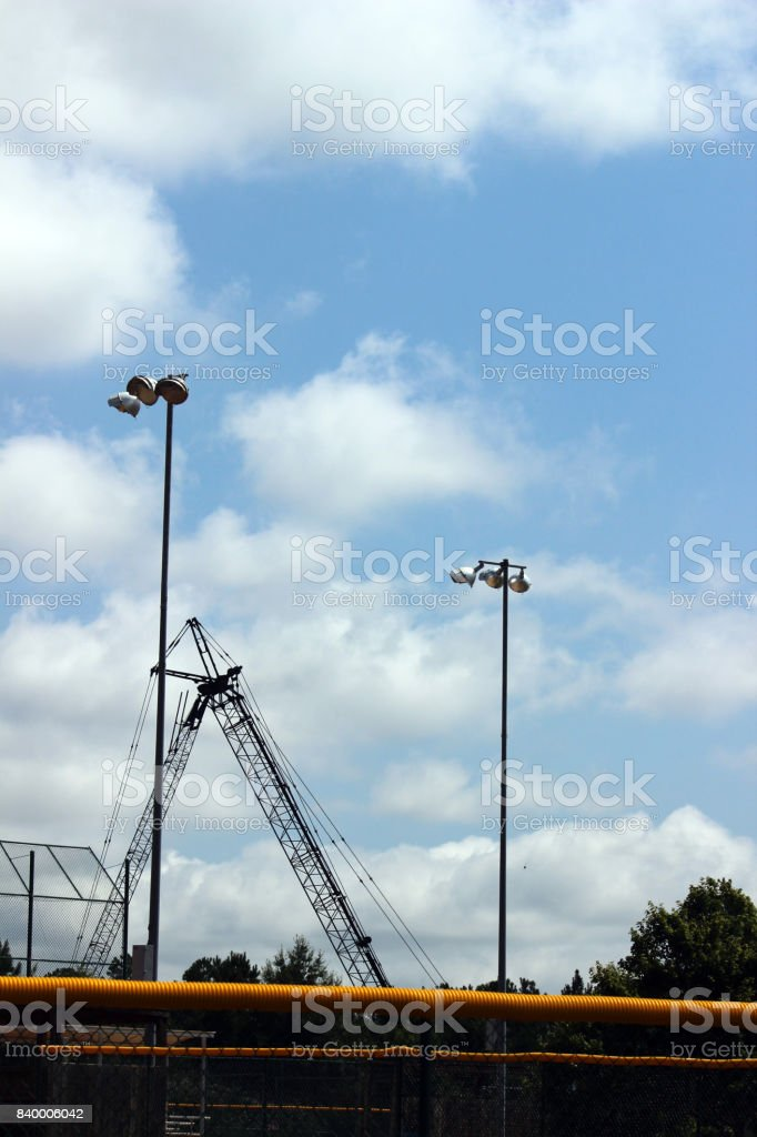 Ball Field Lights with Folded Construction Crane stock photo