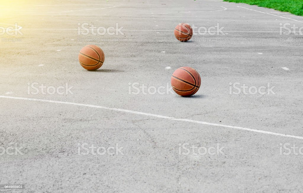 ball for playing basketball lies on the sports ground