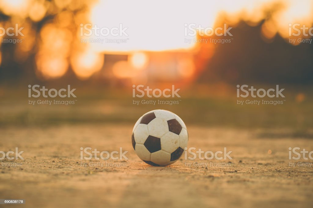 A ball for street soccer football under the sunset ray light. stock photo