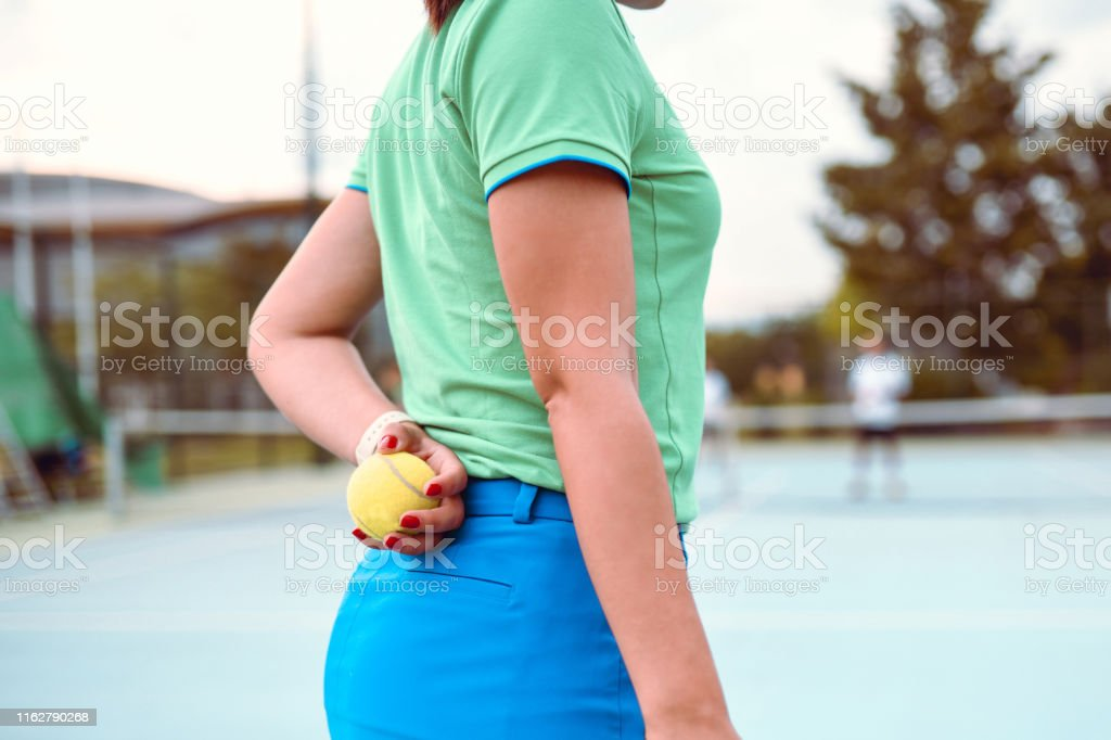 Ball Girl Ready To Pass Tennis Ball To Players