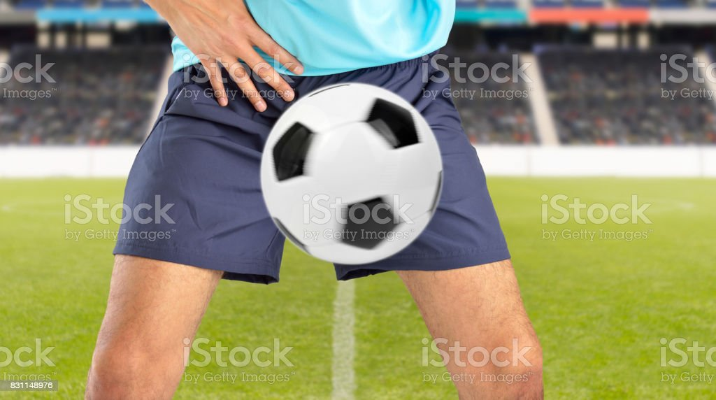 ball hit the crotch stock photo