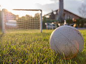 d4a225d3d ... Ball in front of a soccer goal with net in the background outdoors at  sunset ...