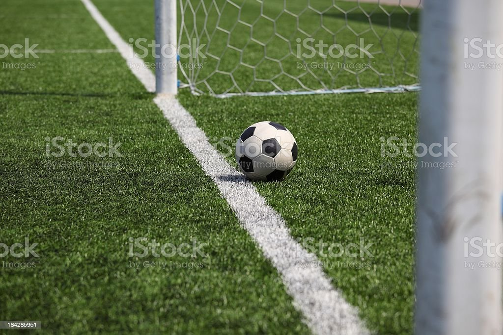 ball in goal post stock photo