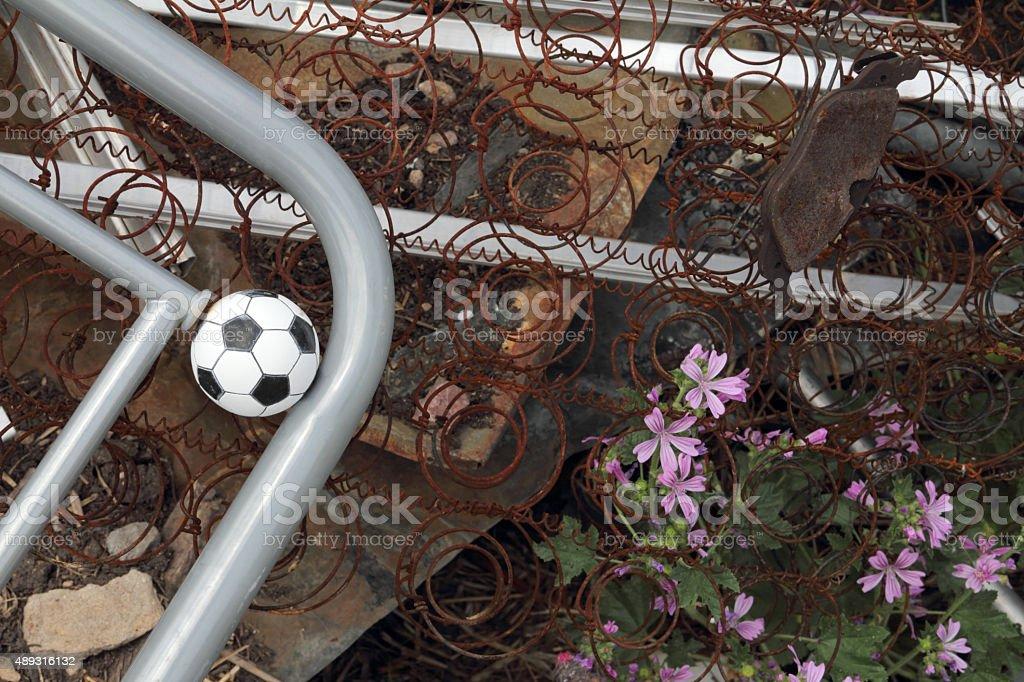 ball in rusty junk stock photo