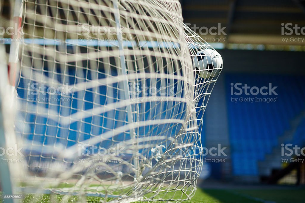 Soccer ball flying into the net