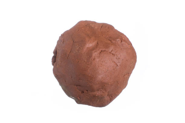 Ball of clay on white stock photo
