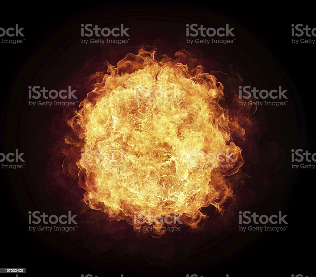 Ball of fire against a black background stock photo