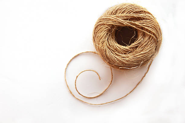 Ball of thick string on white background stock photo