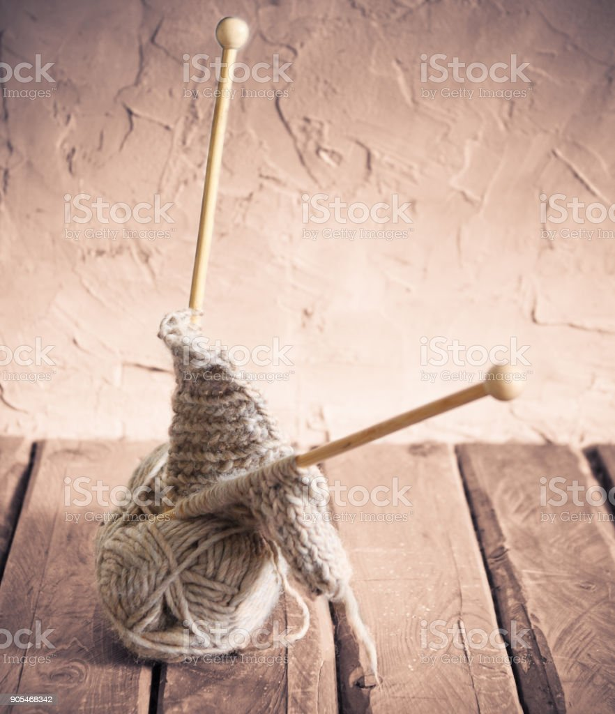 Ball of yarn on a wooden table stock photo