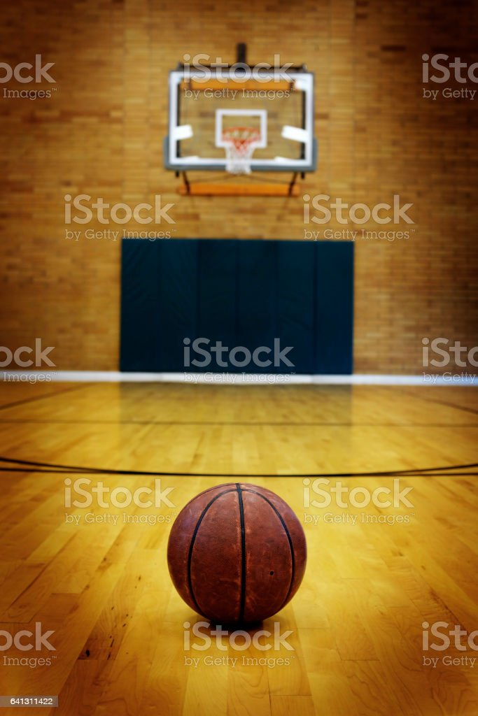 Ball on basketball court for competition and sports stock photo