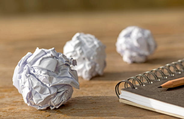 ball paper with notebook on wooden table. stock photo