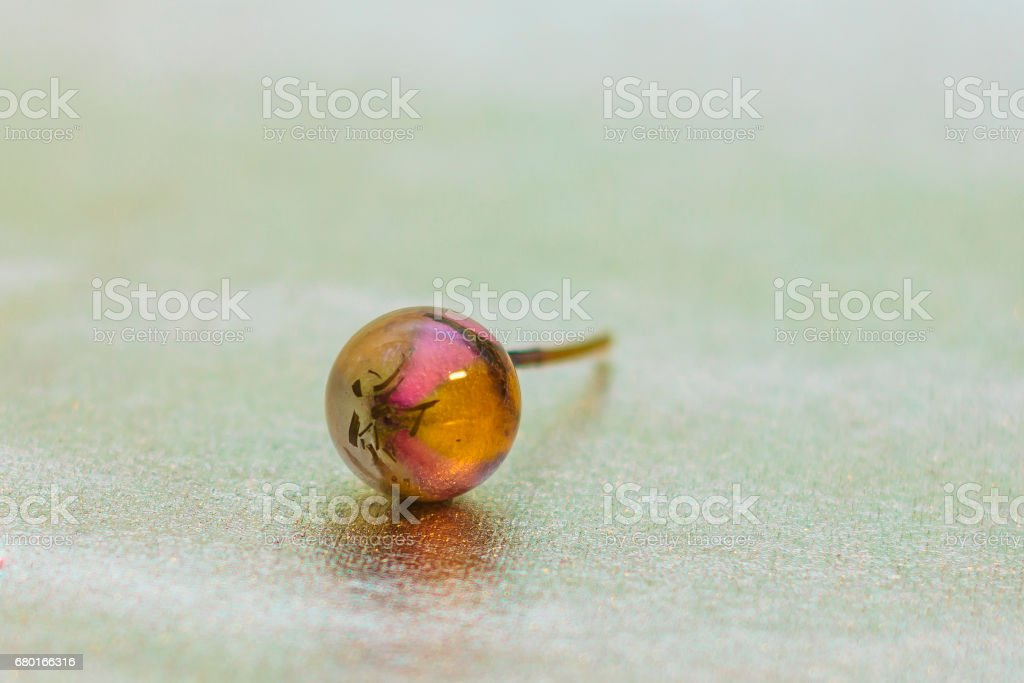 Ball shaped crystal made of epoxy resin and glitters stock photo