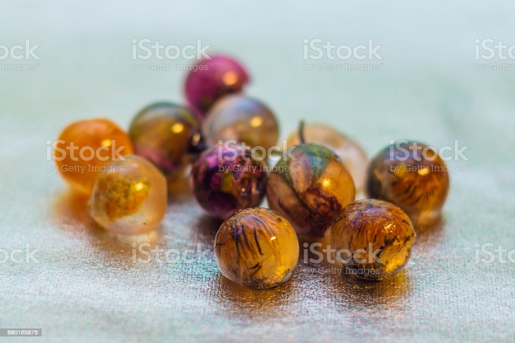 Ball shaped crystals made of epoxy resin and glitters stock photo