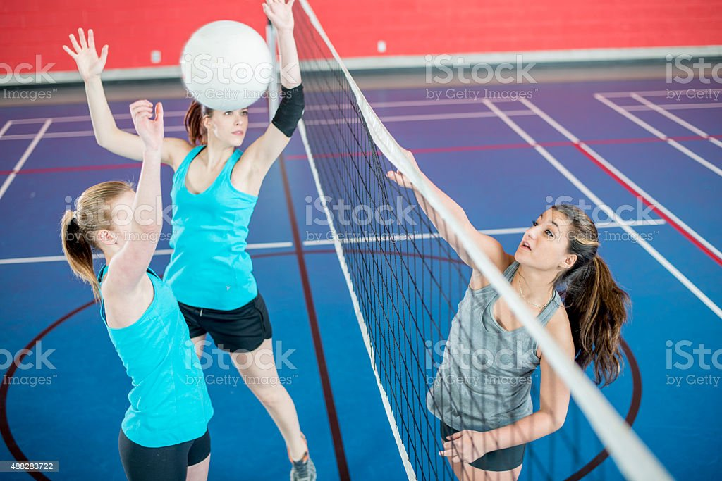 Ball Spiked Over Volleyball Net stock photo
