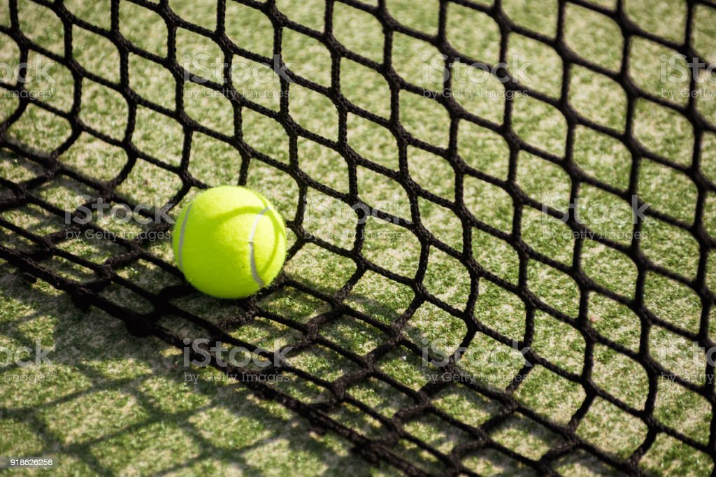 ball tennis padel on artificial grass pitch with net stock photo