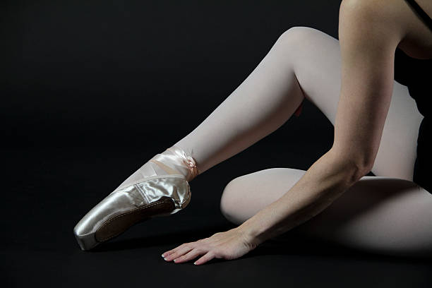 Ballerina and Pink Pointe Ballet Shoe stock photo