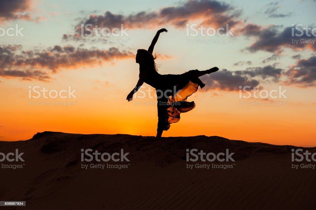 Ballerina at sunset. stock photo