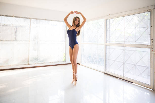 ballerina dancing in a white and bright room - ballet dancer stock photos and pictures
